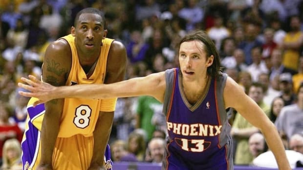 LOS ANGELES - MAY 4:  Steve Nash #13 of the Phoenix Suns puts his arm in front of Kobe Bryant #8 of the Los Angeles Lakers in game six of the Western Conference Quarterfinals during the 2006 NBA Playoffs on May 4, 2006 at the Staples Center in Los Angeles, California. The Suns defeated the Lakers 126-118 in overtime to tie the series 3-3.  NOTE TO USER: User expressly acknowledges and agrees that, by downloading and/or using this Photograph, user is consenting to the terms and conditions of the Getty Images License Agreement.  (Photo by Harry How/Getty Images)