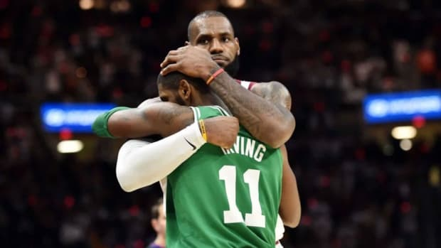 LeBron-and-Kyrie-Irving-share-a-nice-hug-after-Cavaliers-beat-Celtics-in-opener