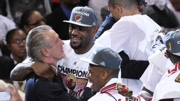 ORG XMIT: USPW-90142 Jun 21, 2012; Miami, FL, USA; Pat Riley hugs Miami Heat small forward LeBron James (6) after winning the 2012 NBA championship at the American Airlines Arena. Miami won 121-106. Mandatory Credit: Derick E. Hingle-US PRESSWIRE ORIG FILE ID:  20120621_ajl_ah6_081.jpg