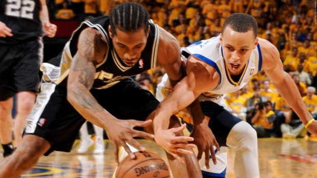 160108205255-kawhi-leonard-stephen-curry-san-antonio-spurs-v-golden-state-warriors---game-six.1200x672