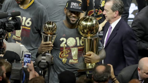 OAKLAND, CA - JUNE 19:  LeBron James #23 of the Cleveland Cavaliers holds the Larry O'Brien Championship Trophy and the Bill Russell NBA Finals Most Valuable Player Award after defeating the Golden State Warriors 93-89 in Game 7 of the 2016 NBA Finals at ORACLE Arena on June 19, 2016 in Oakland, California. NOTE TO USER: User expressly acknowledges and agrees that, by downloading and or using this photograph, User is consenting to the terms and conditions of the Getty Images License Agreement.  (Photo by Ronald Martinez/Getty Images)
