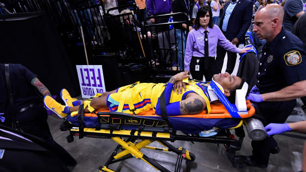 Golden State Warriors' Patrick McCaw (0) is transported by paramedics after sustaining an injury against the Sacramento Kings during the third quarter of their NBA game at the Golden 1 Center in Sacramento, Calif., on Saturday, March 31, 2018. (Jose Carlos Fajardo/Bay Area News Group)