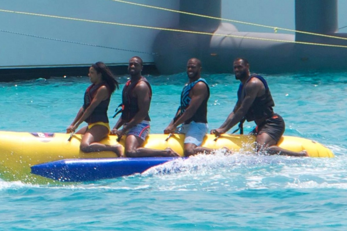 """EXCLUSIVE: The NBA superstars, along with Wade's actress girlfriend Gabrielle Union, were spotted enjoying the off-season like true 'ballers - on a 130ft $17m yacht off the Bahamian island of Staniel Cay. The gang spent at least 3 days anchored off the island, and could be seen having a great time riding jet skis, a banana boat, going down a huge water slide and flying around in a water jet pack. An onlooker said: """"They were definitely having a great time. They had loud music all day. You could see them hanging out and having fun. It was an impressive boat."""" At one point they visited Pig Beach, where tourists can take pictures with wild pigs in the water, but only Gabrielle ventured out to see them. According to one onlooker, LeBron shouted to her """"Those pigs are gonna bite you!"""". Their 3-storey 5-bedroom yacht, the Amarula Sun, is believed to be available for hire from the Bahamian island of Nassau. **NOTE PHOTOS from over the weekend of JULY 4th, 2015**  Pictured: Gabrielle Union, Dwyane Wade, Chris Paul,Lebron James Ref: SPL1072909  070715   EXCLUSIVE Picture by: Splash News  Splash News and Pictures Los Angeles: 310-821-2666 New York: 212-619-2666 London: 870-934-2666 photodesk@splashnews.com"""