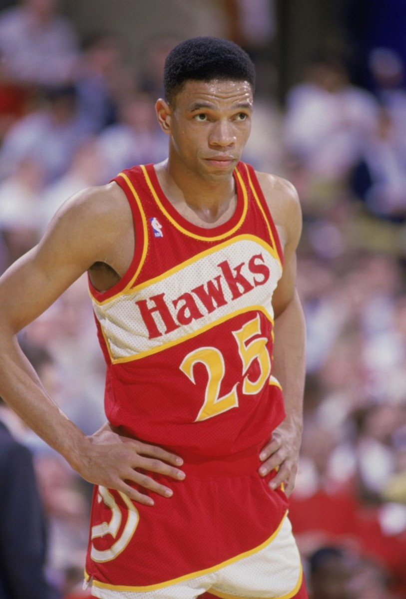 "INGLEWOOD, CA - 1987:  Glenn ""Doc"" Rivers #25 of the Atlanta Hawks stands on the court during a NBA game against the Los Angeles Lakers at the Great Western Forum in Inglewood, California in 1987.  (Photo by Stephen Dunn/Getty Images)"