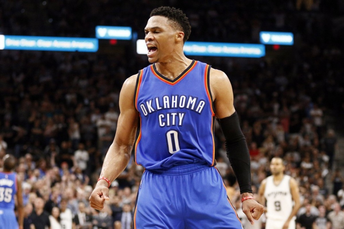 May 10, 2016; San Antonio, TX, USA; Oklahoma City Thunder point guard Russell Westbrook (0) celebrates a basket and a foul against the San Antonio Spurs after scoring in game five of the second round of the NBA Playoffs at AT&T Center. Mandatory Credit: Soobum Im-USA TODAY Sports ORG XMIT: USATSI-268808 ORIG FILE ID:  20160510_ajw_ai1_157.jpg