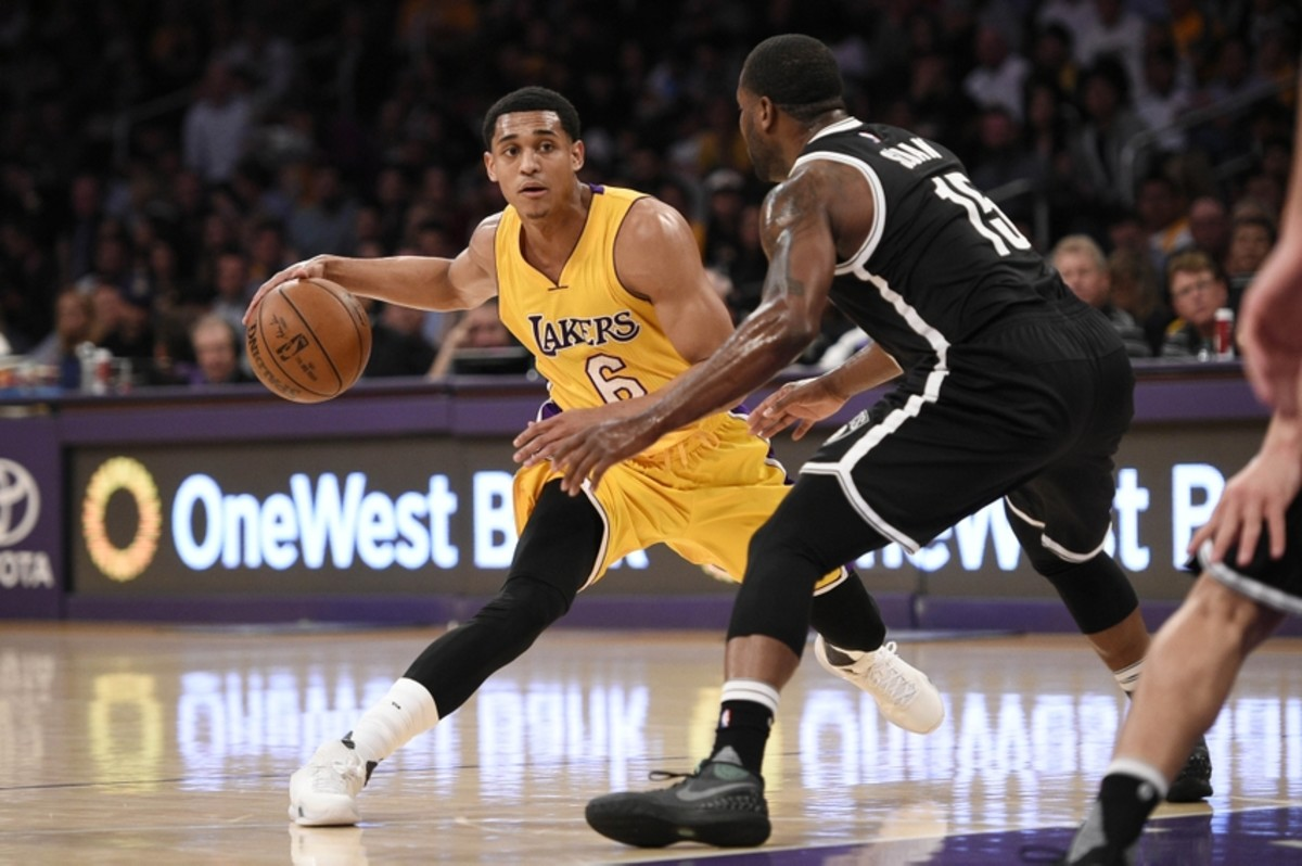 Mar 1, 2016; Los Angeles, CA, USA; Los Angeles Lakers guard Jordan Clarkson (6) handles the ball as Brooklyn Nets guard Donald Sloan (right) defends during the first quarter at Staples Center. Mandatory Credit: Kelvin Kuo-USA TODAY Sports