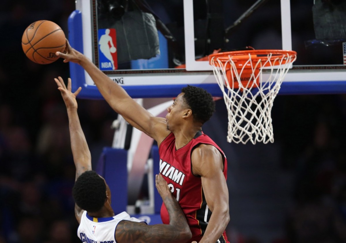 Nov 25, 2015; Auburn Hills, MI, USA; Miami Heat center Hassan Whiteside (21) blocks the shot of Detroit Pistons guard Kentavious Caldwell-Pope (5) during the second quarter of the game at The Palace of Auburn Hills. The Pistons defeated the Heat 104-01. Mandatory Credit: Leon Halip-USA TODAY Sports