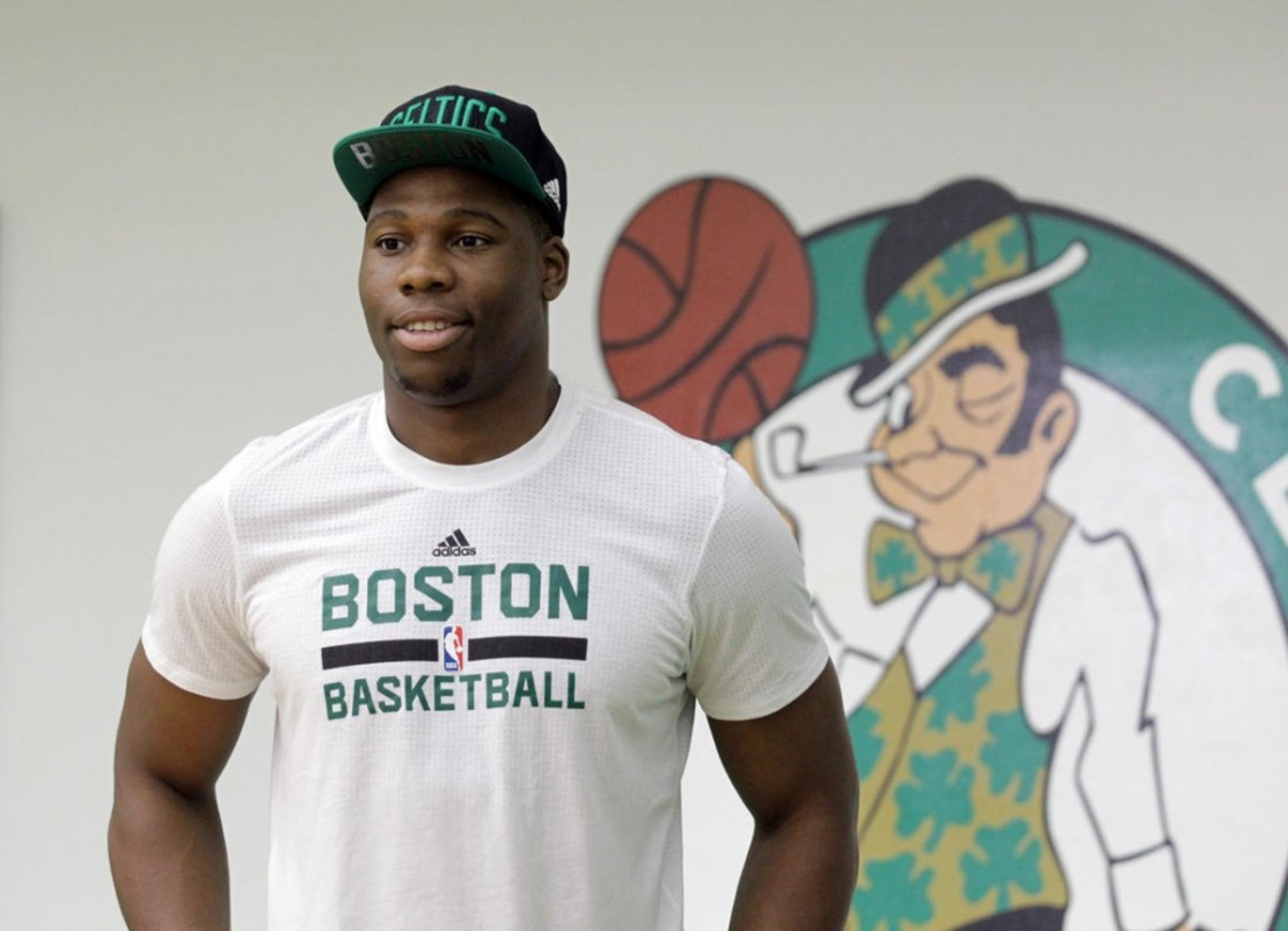 (Waltham, MA 06/24/16) Guerschon Yabusele poses for a picture after the Celtics press conference introducing five of their six 2016 draft picks. Friday, June 24, 2016. Staff photo by John Wilcox.