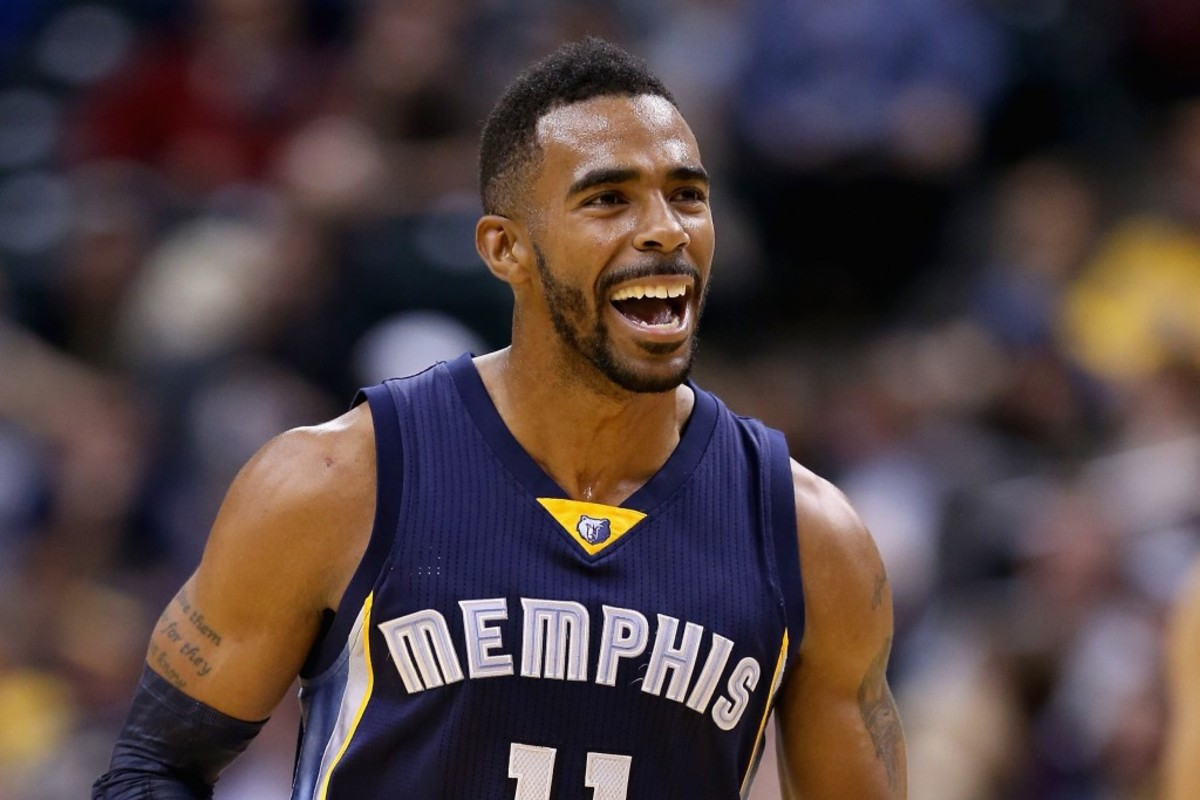 INDIANAPOLIS, IN - OCTOBER 31: Mike Conley #11 of the Memphis Grizzlies celebrates during the game against the Indiana Pacers at Bankers Life Fieldhouse on October 31, 2014 in Indianapolis, Indiana.NOTE TO USER: User expressly acknowledges and agrees that, by downloading and or using this Photograph, user is consenting to the terms and conditions of the Getty Images License Agreement. Mandatory Copyright Notice:   Andy Lyons/Getty Images/AFP