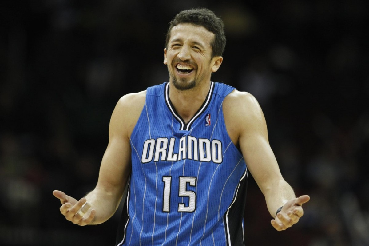 Orlando Magic's Hedo Turkoglu, who scored 20 points in his team's points in a  104-88 win over the New Jersey Nets, smiles during the third quarter of an NBA basketball game, Monday, Dec. 27, 2010, in Newark, N.J. (AP Photo/Julio Cortez)