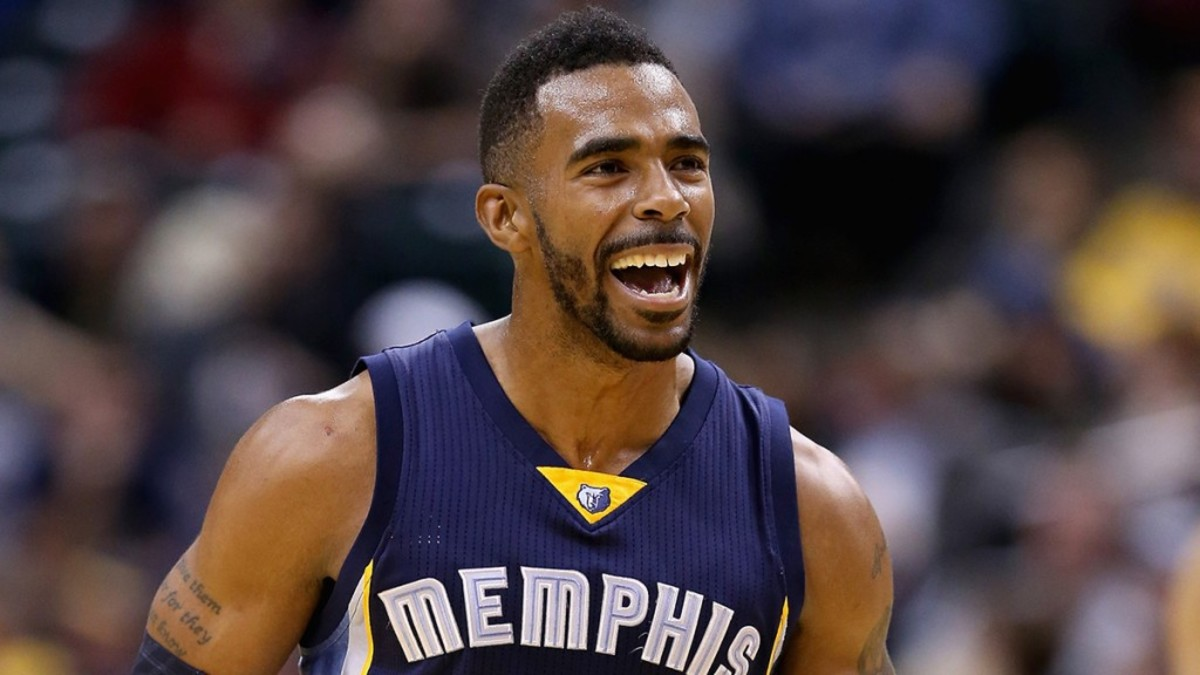 INDIANAPOLIS, IN - OCTOBER 31:  Mike Conley #11 of the Memphis Grizzlies celebrates  during the game against the Indiana Pacers at Bankers Life Fieldhouse on October 31, 2014 in Indianapolis, Indiana.NOTE TO USER: User expressly acknowledges and agrees that, by downloading and or using this Photograph, user is consenting to the terms and conditions of the Getty Images License Agreement. Mandatory Copyright Notice:  (Photo by Andy Lyons/Getty Images)