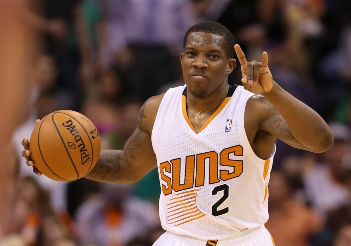 PHOENIX, AZ - MARCH 12:  Eric Bledsoe #2 of the Phoenix Suns handles the ball during the NBA game against the Cleveland Cavaliers at US Airways Center on March 12, 2014 in Phoenix, Arizona.  NOTE TO USER: User expressly acknowledges and agrees that, by downloading and or using this photograph, User is consenting to the terms and conditions of the Getty Images License Agreement.  (Photo by Christian Petersen/Getty Images)