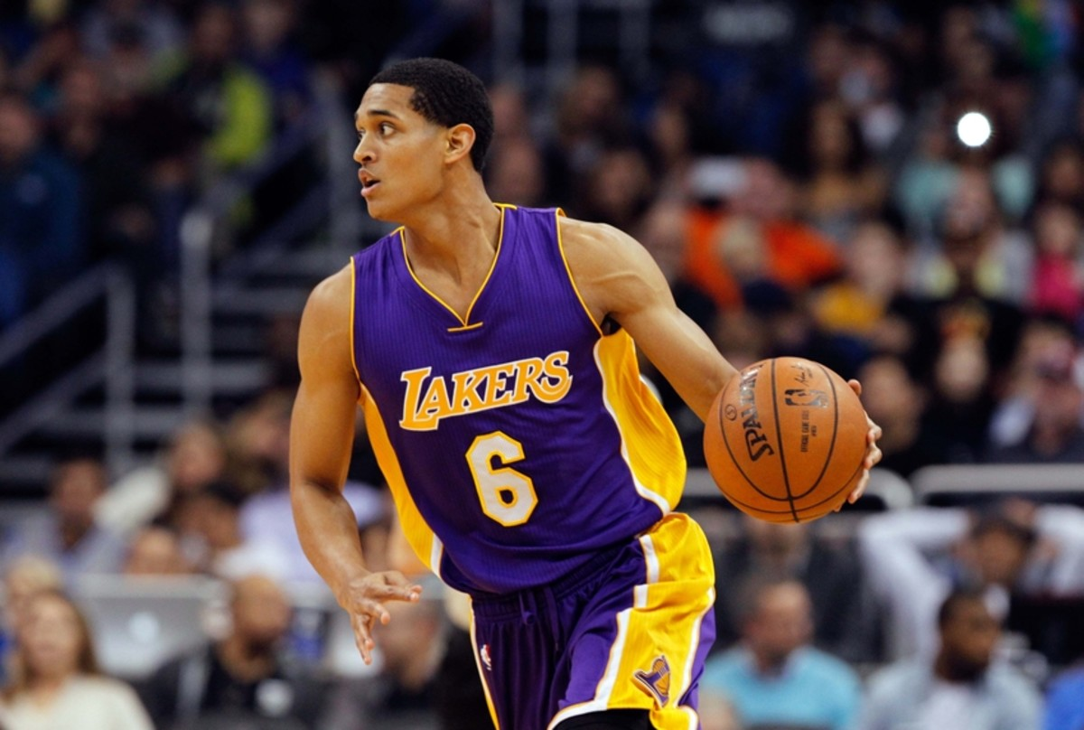 Feb 6, 2015; Orlando, FL, USA; Los Angeles Lakers guard Jordan Clarkson (6) dribbles the ball against the Orlando Magic during the second quarter at Amway Center. Mandatory Credit: Kim Klement-USA TODAY Sports