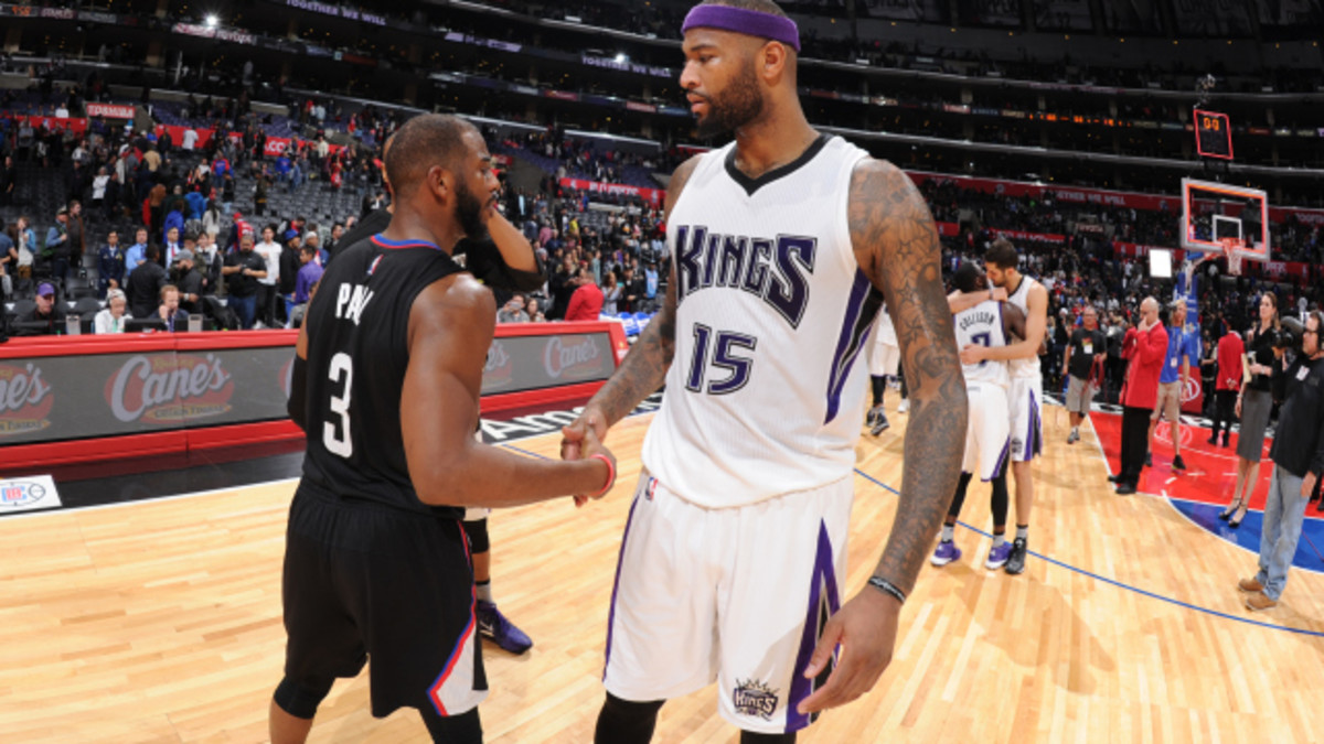 LOS ANGELES, CA - JANUARY 16: Chris Paul #3 of the Los Angeles Clippers high fives DeMarcus Cousins #15 of the Sacramento Kings after the game on January 16, 2016 at STAPLES Center in Los Angeles, California. NOTE TO USER: User expressly acknowledges and agrees that, by downloading and or using this Photograph, user is consenting to the terms and conditions of the Getty Images License Agreement. Mandatory Copyright Notice: Copyright 2016 NBAE (Photo by Andrew Bernstein/NBAE via Getty Images)