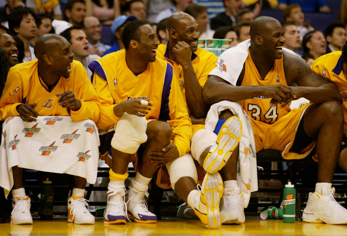 The Los Angeles Lakers, gary Payton, Kobe Bryant, Karl Malone and Shaquille O'Neal, from left, enjoy the final minutes of the Lakers' 107-88 victory over the New Orleans Hornets Tuesday March 30, 2004 at the Staples Center.  PHOTO:  KEVIN SULLIVAN/ORANGE COUNTY REGISTER/SCNG