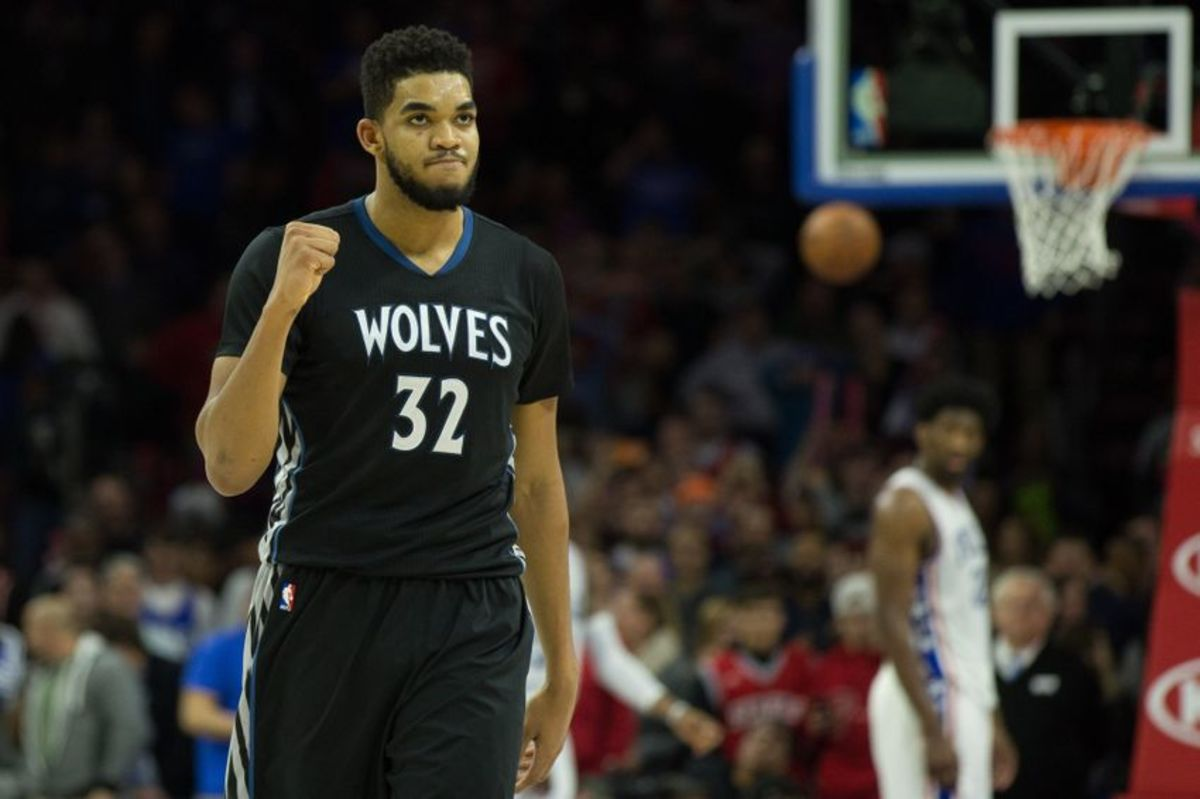 Jan 3, 2017; Philadelphia, PA, USA; Minnesota Timberwolves center Karl-Anthony Towns (32) reacts in front of Philadelphia 76ers center Joel Embiid (21) after a score during the fourth quarter at Wells Fargo Center. The Philadelphia 76ers won 93-91. Mandatory Credit: Bill Streicher-USA TODAY Sports