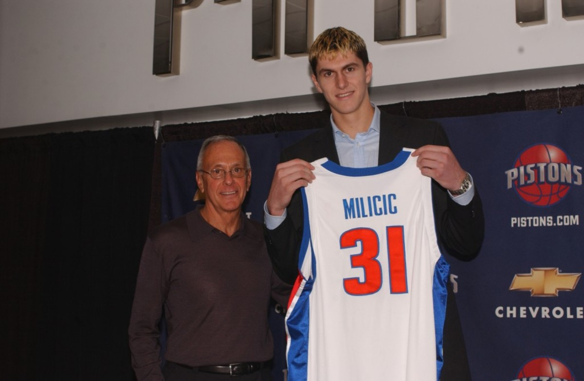 AUBURN HILLS, MI - JUNE 27: Darko Milicic, 2nd pick of the 2003 NBA draft, holds his new uniform with Detroit Pistons coach Larry Brown at the Palace of Auburn Hills June 27, 2003 in Auburn Hills, Michigan. NOTE TO USER: User expressly acknowledges and agrees that, by downloading and or using this photograph, User is consenting to the terms and conditions of the Getty Images License Agreement. (Photo by Allen Einstein/NBAE/Getty Images)