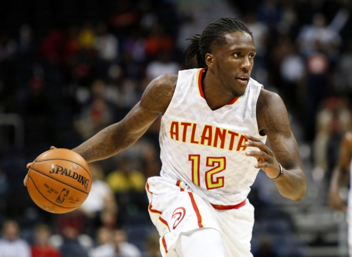 Oct 13, 2016; Atlanta, GA, USA; Atlanta Hawks forward Taurean Prince (12) drives to the basket against the Detroit Pistons in the fourth quarter at Philips Arena. The Pistons defeated the Hawks 99-94. Mandatory Credit: Brett Davis-USA TODAY Sports