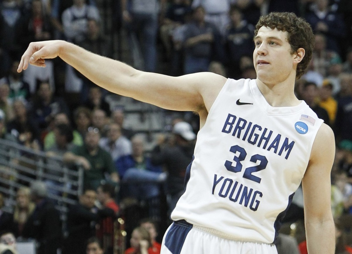 BYU guard Jimmer Fredette (32) reacts after scoring against Wofford during the second half of a Southeast regional second round NCAA tournament college basketball game, Thursday, March 17, 2011, in Denver. Fredette scores 32 points, leading BYU to a 74-66 win. (AP Photo/Ed Andrieski)