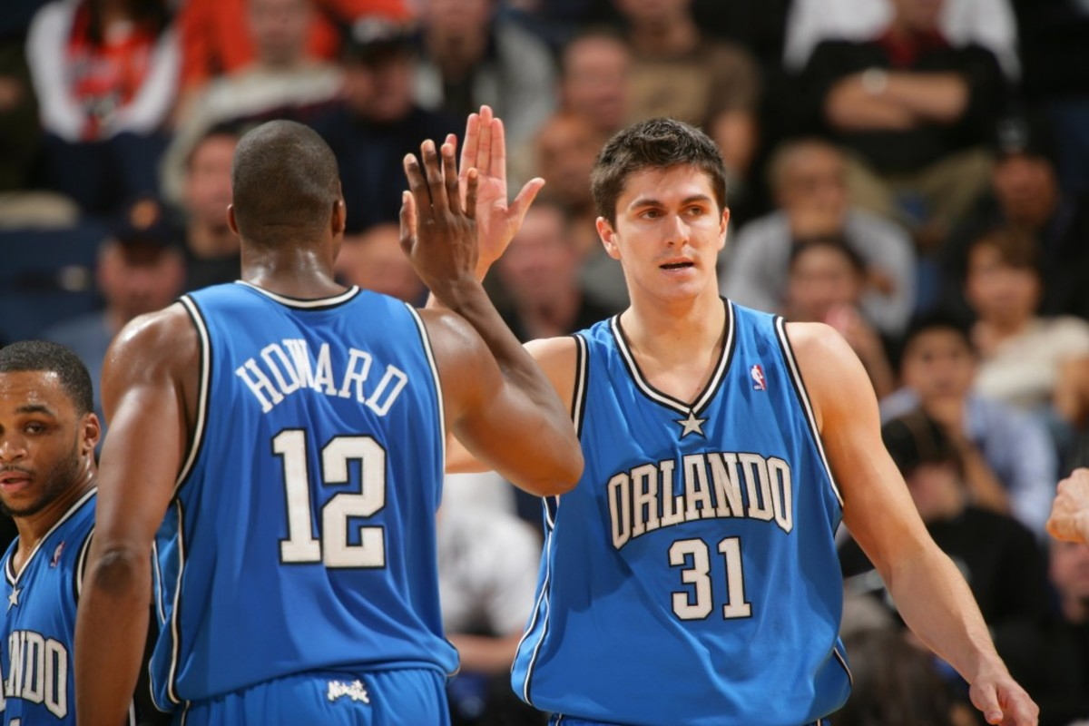 OAKLAND, CA - JANUARY 10:  Darko Milicic #31 and Dwight Howard #12 of the Orlando Magic celebrate a victory over the Golden State Warriors in NBA action January 10, 2007 at Oracle Arena in Oakland, California. NOTE TO USER: User expressly acknowledges and agrees that, by downloading and or using this photograph, user is consenting to the terms and conditions of Getty Images License Agreement. Mandatory Copyright Notice: Copyright 2006 NBAE (Photo by Rocky Widner/NBAE via Getty Images)
