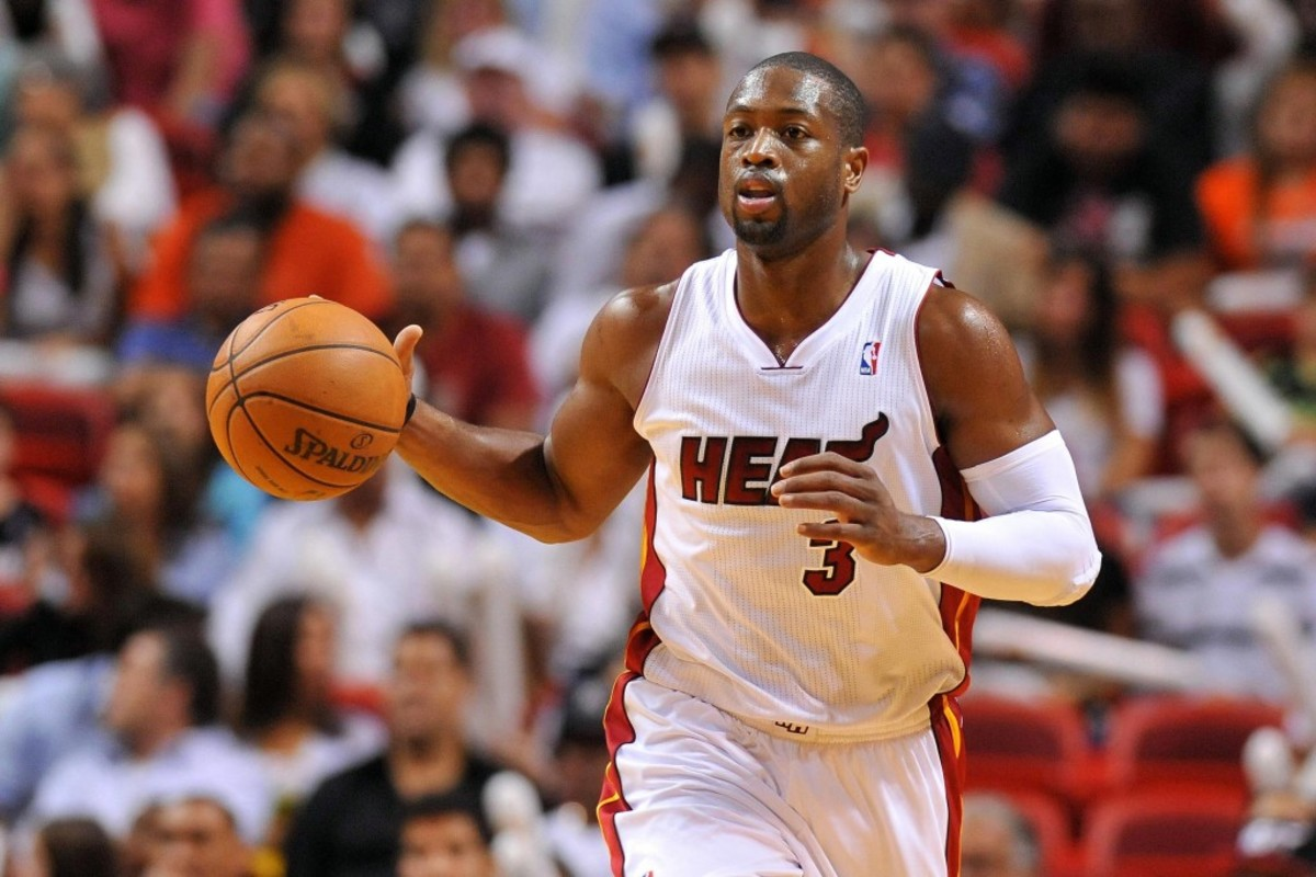 Nov 12, 2013; Miami, FL, USA; Miami Heat shooting guard Dwyane Wade (3) dribbles the basketball against the Milwaukee Bucks during the second half at American Airlines Arena. The Heat won 118-95. Mandatory Credit: Steve Mitchell-USA TODAY Sports