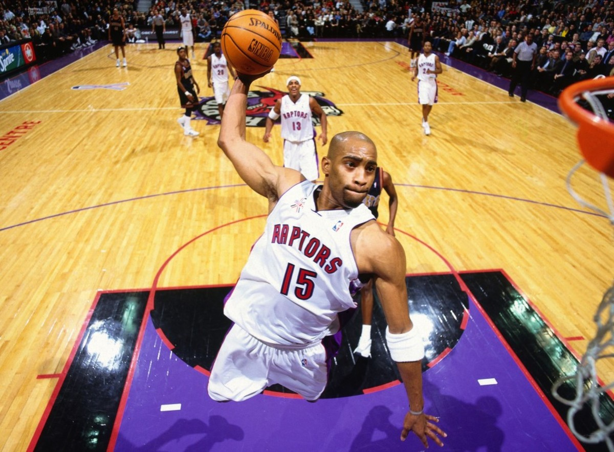 TORONTO, CANADA - 2001:  Vince Carter #15 of the Toronto Raptors dunks the ball against the Denver Nuggets at Air Canada Centre in Toronto, Canada circa 2001. NOTE TO USER: User expressly acknowledges and agrees that, by downloading and/or using this Photograph, user is consenting to the terms and conditions of the Getty Images License Agreement. Mandatory Copyright Notice: Copyright 1991 NBAE (Photo by Nat Butler/NBAE via Getty Images)