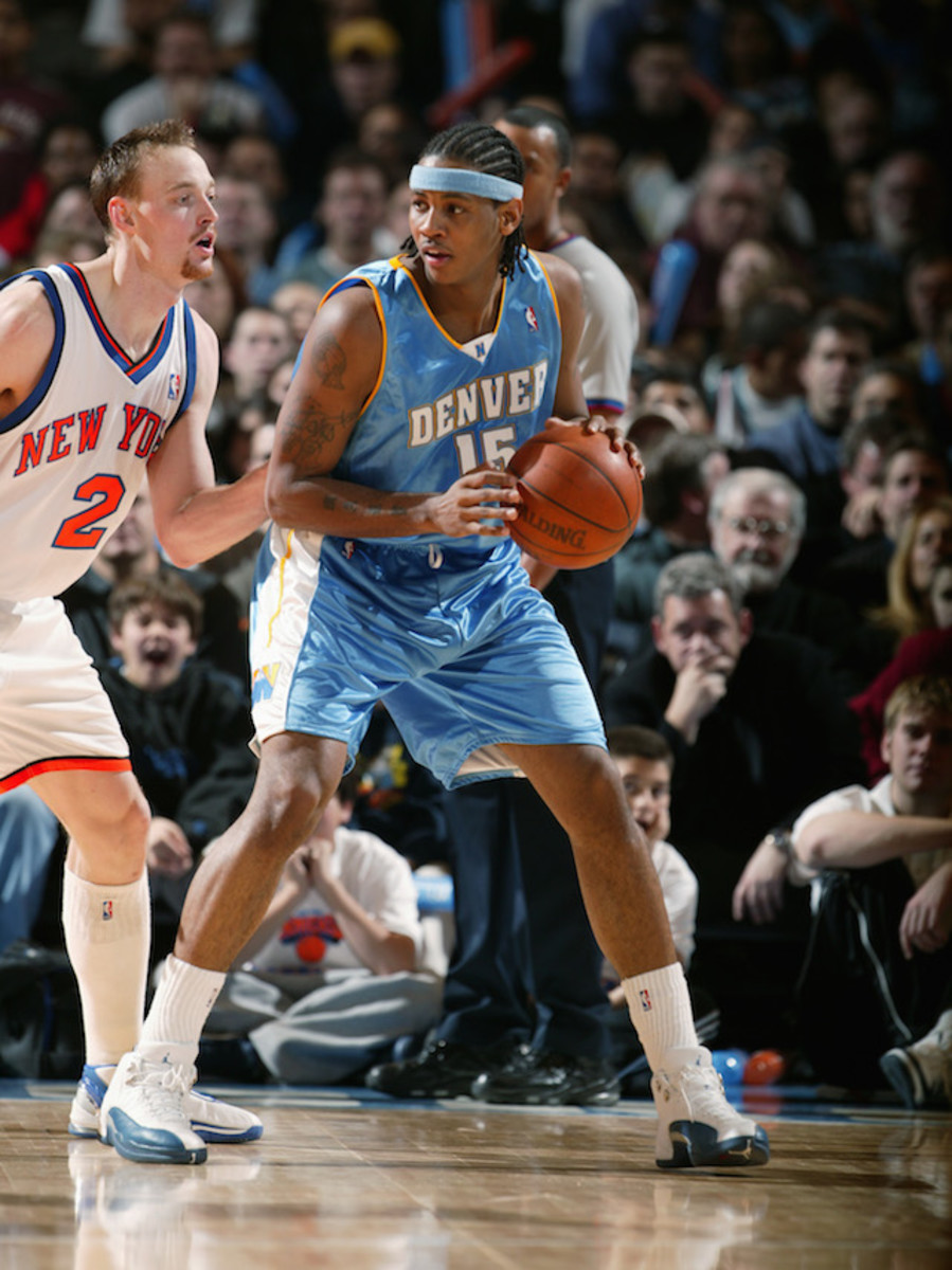 NEW YORK - DECEMBER 13:  Carmelo Anthony #15 of the Denver Nuggets posts up against Keith Van Horn #2 of the New York Knicks during the game at Madison Square Garden on December 13, 2003 in New York, New York.  The Knicks won 95-88.  NOTE TO USER: User expressly acknowledges and agrees that, by downloading and/or using this Photograph, User is consenting to the terms and conditions of the Getty Images License Agreement.  (Photo by Nathaniel S. Butler/NBAE via Getty Images)