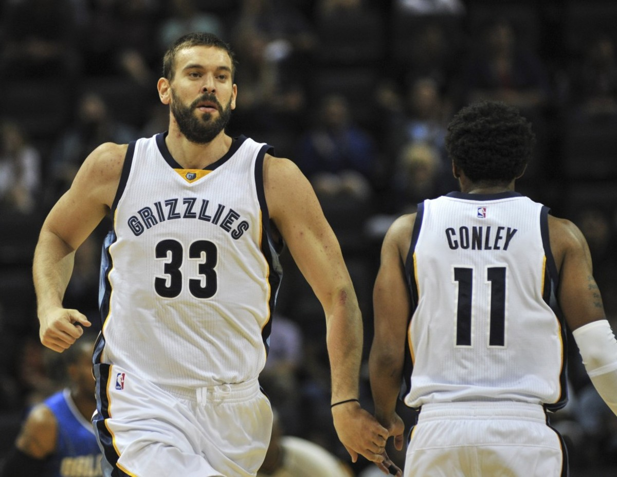 Oct 3, 2016; Memphis, TN, USA; Memphis Grizzlies center Marc Gasol (33) and guard Mike Conley (11) react against the Orlando Magic during the second half at FedExForum. Memphis beat Orlando 102-97. Mandatory Credit: Justin Ford-USA TODAY Sports