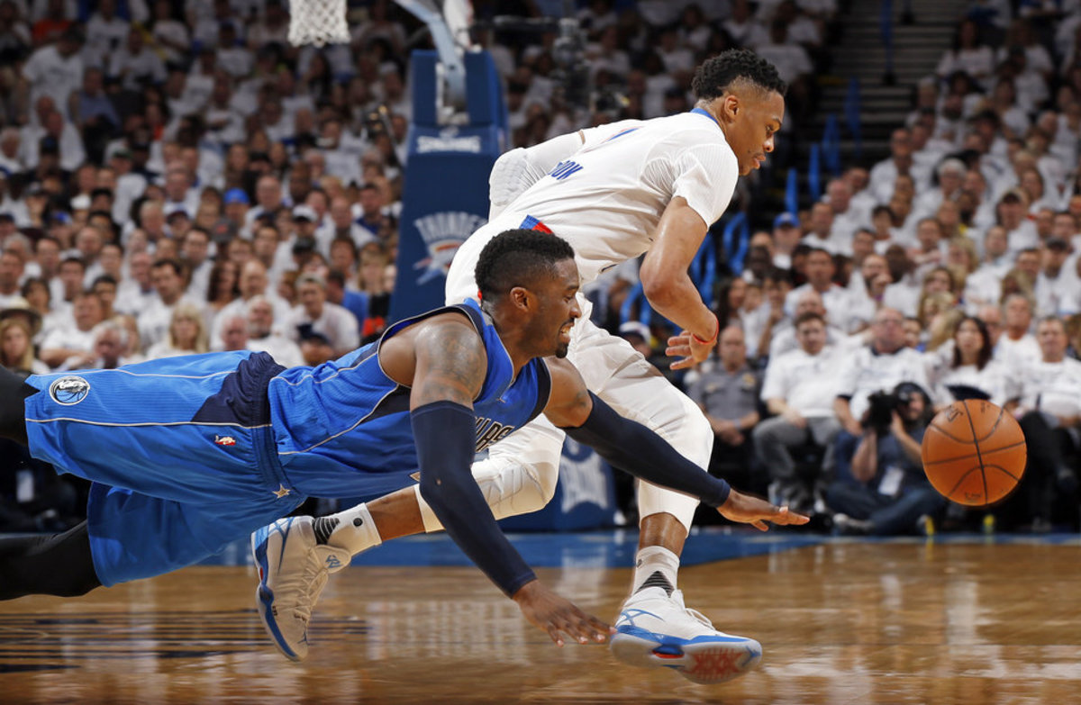 Dallas' Wesley Matthews (23) and Oklahoma City's Russell Westbrook (0) chase the ball during Game 2 of the first round series between the Oklahoma City Thunder and the Dallas Mavericks in the NBA playoffs at Chesapeake Energy Arena in Oklahoma City, Monday, April 18, 2016. Dallas won 85-84. Photo by Nate Billings, The Oklahoman