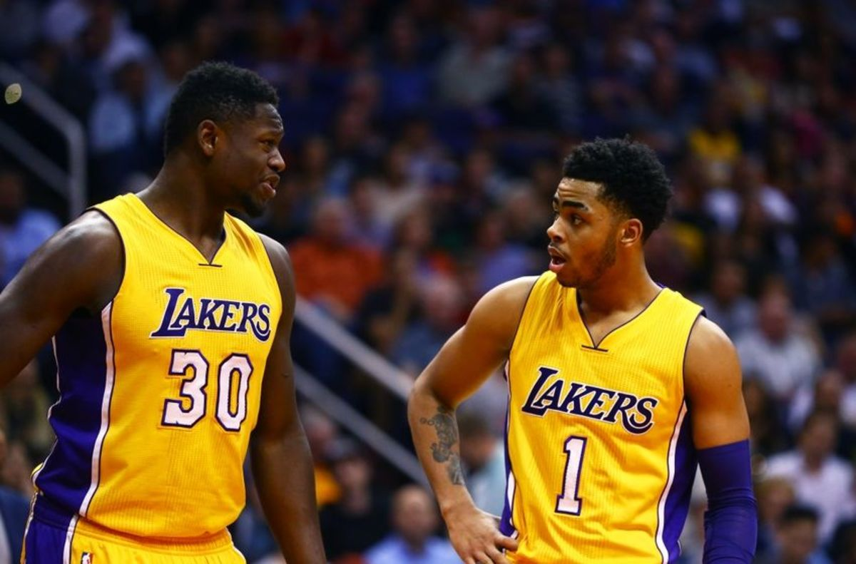 Mar 23, 2016; Phoenix, AZ, USA; Los Angeles Lakers forward Julius Randle (30) and guard D'Angelo Russell (1) against the Phoenix Suns at Talking Stick Resort Arena. The Suns defeated the Lakers 119-107. Mandatory Credit: Mark J. Rebilas-USA TODAY Sports