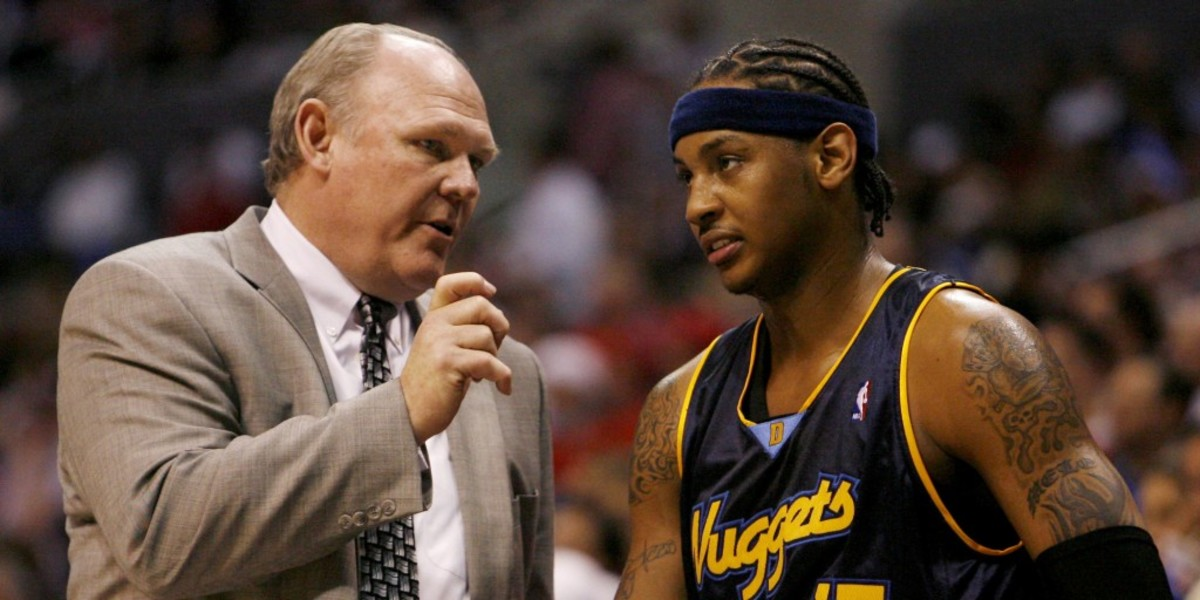 Denver Nuggets head coach George Karl (L) talks with Carmelo Anthony during a time out of their 98-87 loss to the Los Angeles Clippers in game 2 of the NBA Western Conference first round playoff series in Los Angeles, April 24, 2006. REUTERS/Danny Moloshok