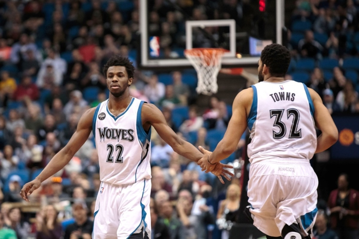 Apr 3, 2016; Minneapolis, MN, USA; Minnesota Timberwolves forward Andrew Wiggins (22) high fives center Karl-Anthony Towns (32) in the third quarter against the Dallas Mavericks at Target Center. The Dallas Mavericks beat the Minnesota Timberwolves 88-78. Mandatory Credit: Brad Rempel-USA TODAY Sports