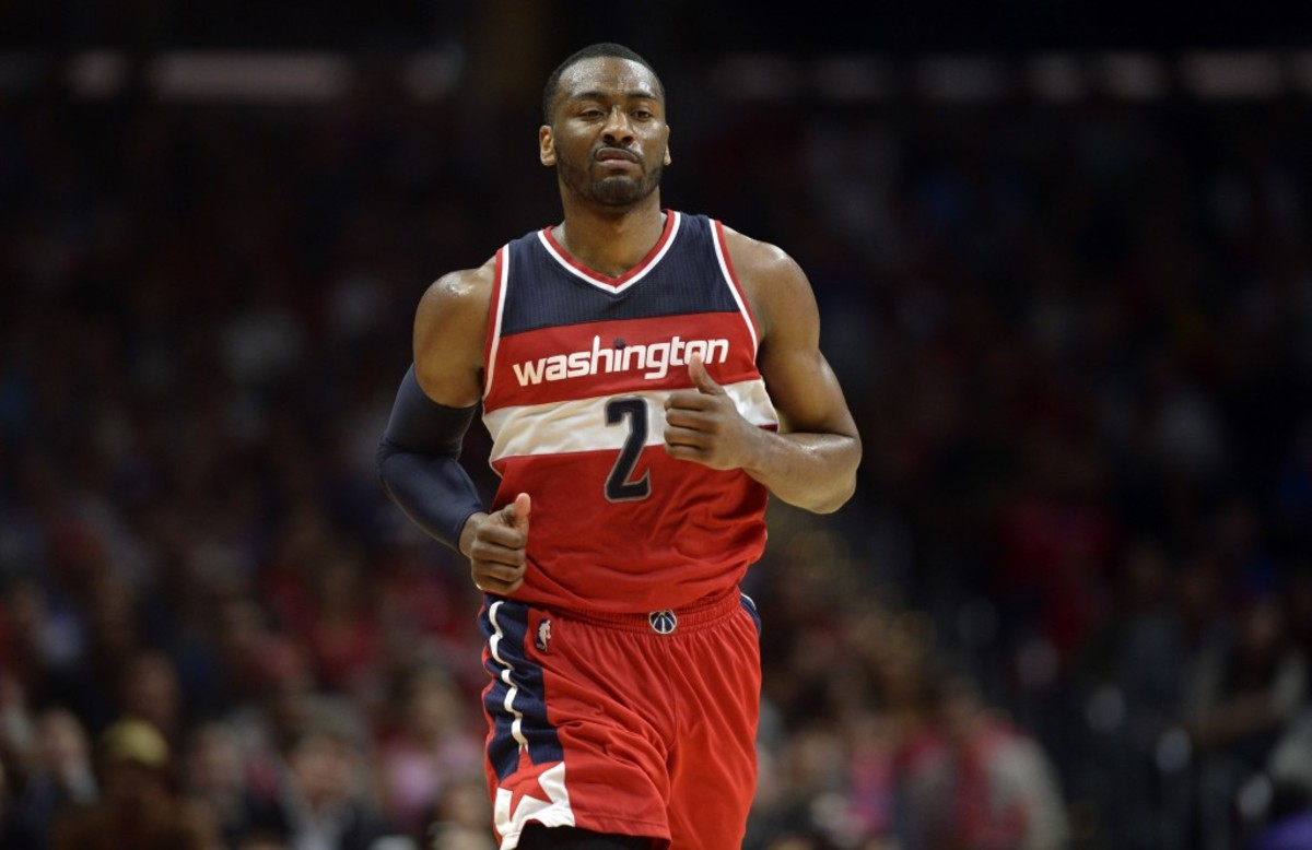 Mar 20, 2015; Los Angeles, CA, USA; Washington Wizards guard John Wall (2) reacts after making a shot during the fourth quarter against the Los Angeles Clippers at Staples Center. The Los Angeles Clippers won 113-99. Mandatory Credit: Kelvin Kuo-USA TODAY Sports