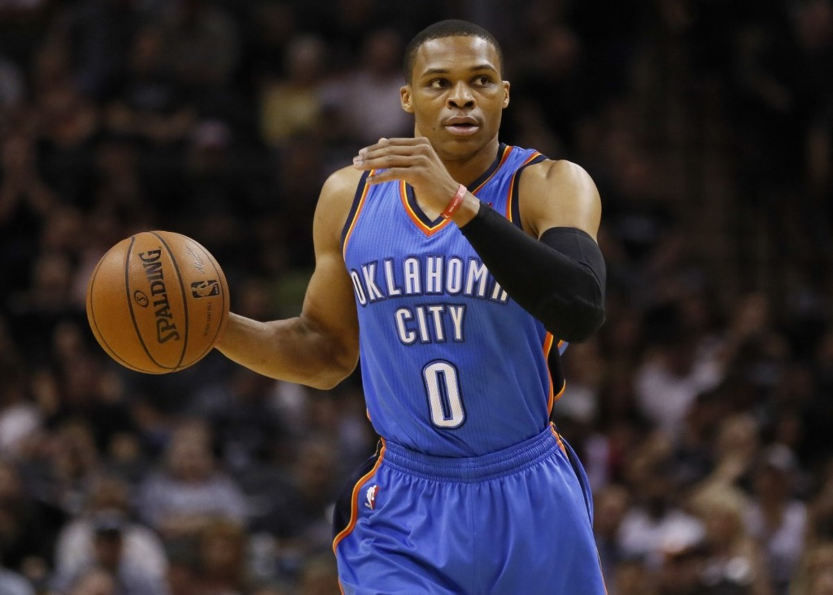May 29, 2014; San Antonio, TX, USA; Oklahoma City Thunder guard Russell Westbrook (0) dribbles during the first quarter against the San Antonio Spurs in game five of the Western Conference Finals of the 2014 NBA Playoffs at AT&T Center. Mandatory Credit: Soobum Im-USA TODAY Sports