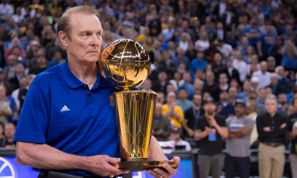 March 23, 2015; Oakland, CA, USA; Golden State Warriors former player Rick Barry holds the 1975 NBA Championship trophy during a 40th anniversary celebration during the game against the Washington Wizards at Oracle Arena. Mandatory Credit: Kyle Terada-USA TODAY Sports ORG XMIT: USATSI-188338 ORIG FILE ID:  20150323_kkt_st3_047.jpg