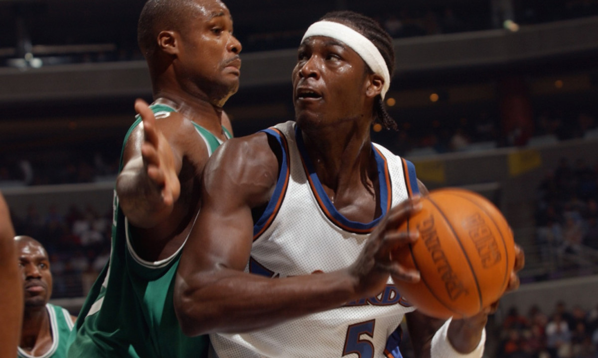 WASHINGTON - OCTOBER 31:  Kwame Brown #5 of the Washington Wizards is defended by Antoine Walker #8 of the Boston Celtics during the game at MCI Center on October 31, 2002 in Washington, D.C.  The Wizards won 114-69.  NOTE TO USER: User expressly acknowledges and agrees that, by downloading and/or using this Photograph, User is consenting to the terms and conditions of the Getty Images License Agreement (Photo by Doug Pensinger/Getty Images)