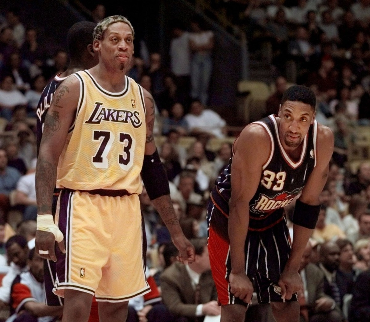 Los Angeles Lakers' Dennis Rodman, left, and Houston Rockets' Scottie Pippen stand at the foul line for their first meeting since both players were teammates on the Chicago Bulls Sunday, Feb. 28, 1999, in Inglewood, Calif.(AP Photo/Kevork Djansezian)