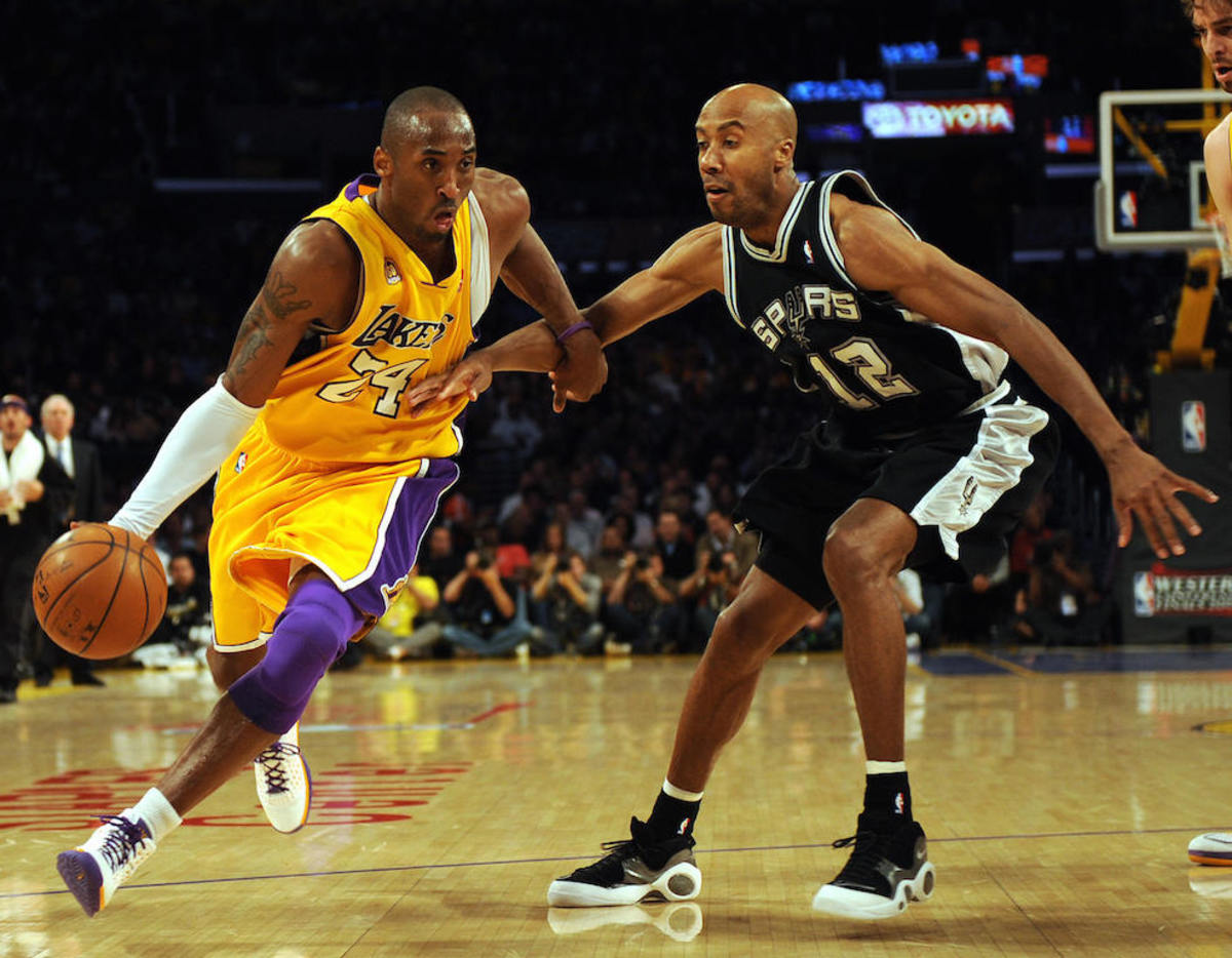 Pau Gasol (R) of the Los Angeles Lakers moves the ball before Bruce Bowen of the San Antonio Spurs in Game Two of the Western Conference Finals during the 2008 NBA Playoffs on May 21, 2008 at Staples Center in Los Angeles, California.  Bryant scored 22 points and the Los Angeles Lakers moved closer to a berth in the National Basketball Association Finals by devastating defending NBA champion San Antonio 101-71. AFP PHOTO / GABRIEL BOUYS (Photo credit should read GABRIEL BOUYS/AFP/Getty Images)