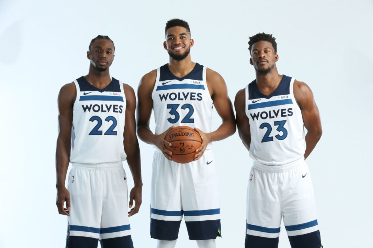 MINNEAPOLIS, MN - SEPTEMBER 22:  Andrew Wiggins #22, Karl-Anthony Towns #32 and Jimmy Butler #23 of the Minnesota Timberwolves pose for portraits during the 2017 Media Day on September 22, 2017 at the Minnesota Timberwolves and Lynx Courts at Mayo Clinic Square in Minneapolis, Minnesota.  NOTE TO USER:  User expressly acknowledges and agrees that, by downloading and or using this Photograph, user is consenting to the terms and conditions of the Getty Images License Agreement. Mandatory Copyright Notice: Copyright 2017 NBAE (Photo by David Sherman/NBAE via Getty Images)