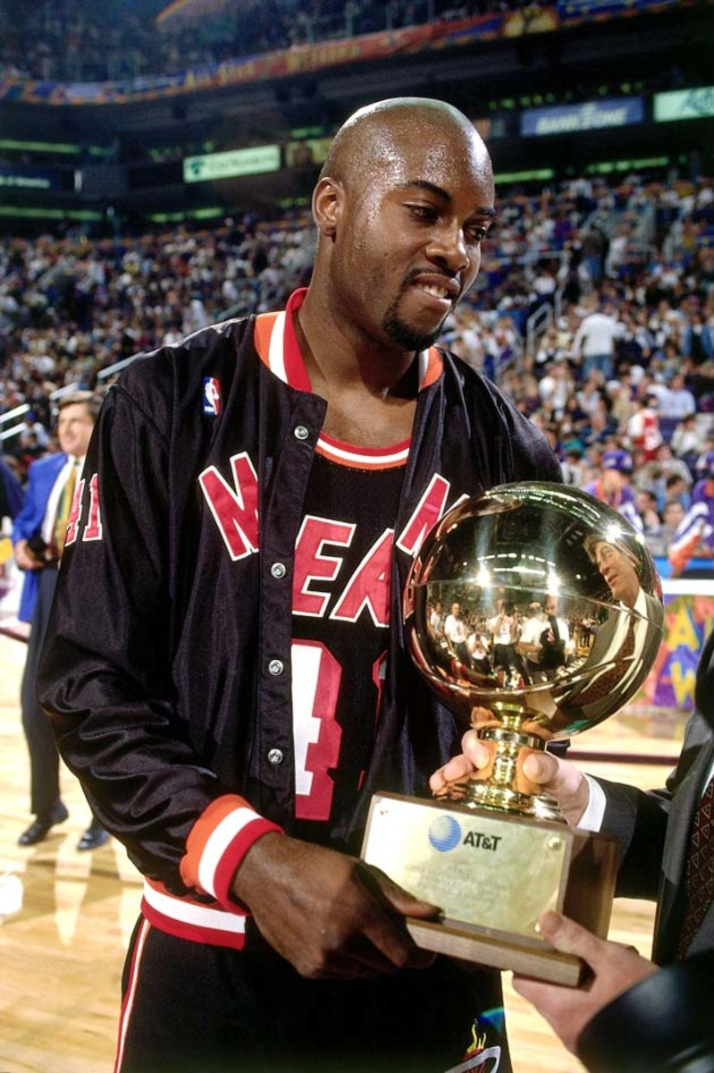 PHOENIX - FEBRUARY 11:  Glen Rice #41 of the Miami Heat poses with the trophy after winning the 1995 AT&T Three Point Shootout on February 11, 1995 at the America West Arena in Phoenix, Arizona.  NOTE TO USER: User expressly acknowledges that, by downloading and or using this photograph, User is consenting to the terms and conditions of the Getty Images License agreement. Mandatory Copyright Notice: Copyright 1995 NBAE (Photo by Andrew D. Bernstein/NBAE via Getty Images)