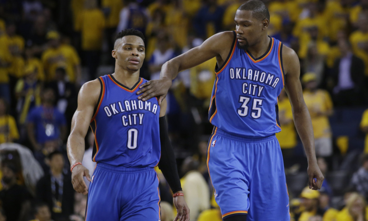 Oklahoma City Thunder's Kevin Durant (35) pats teammate Russell Westbrook (0) on the shoulder as they take a lead over the Golden State Warriors during the second half in Game 1 of the NBA basketball Western Conference finals Monday, May 16, 2016, in Oakland, Calif. Oklahoma City won 108-102. (AP Photo/Marcio Jose Sanchez)  ORG XMIT: OAS214