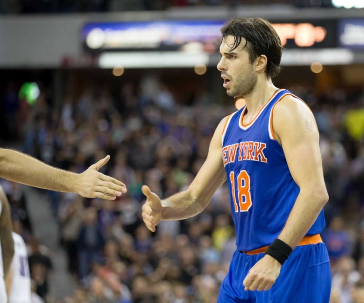 Dec 10, 2015; Sacramento, CA, USA; New York Knicks guard Sasha Vujacic (18) high fives teammates during the fourth quarter against the New York Knicks at Sleep Train Arena. The Sacramento Kings defeated the New York Knicks 99-97. Mandatory Credit: Kelley L Cox-USA TODAY Sports