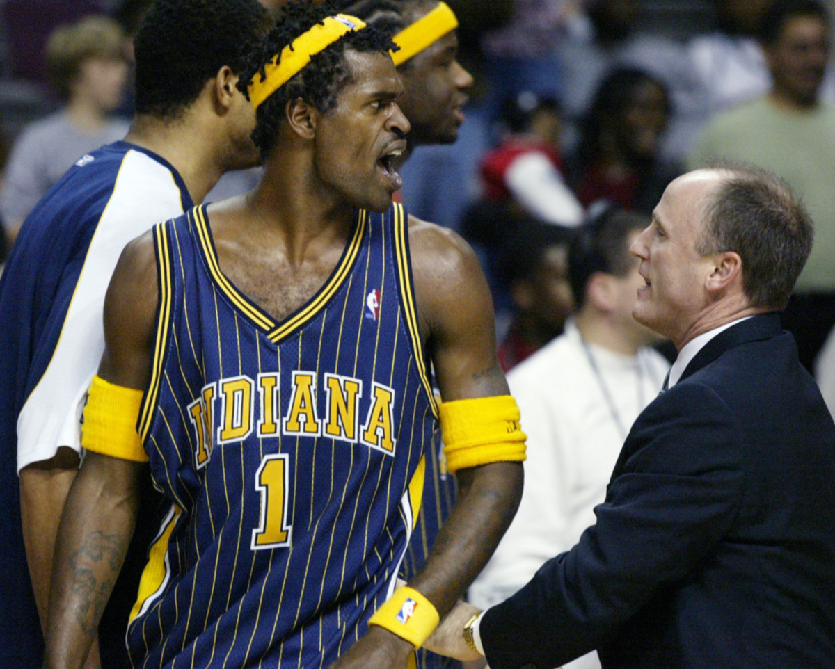Indiana Pacers' Stephen Jackson (1) is escorted off the court by  following their fight with the Detroit Pistons and fans Friday, Nov. 19, 2004, in Auburn Hills, Mich. (AP Photo/Duane Burleson) ORG XMIT: DCB105