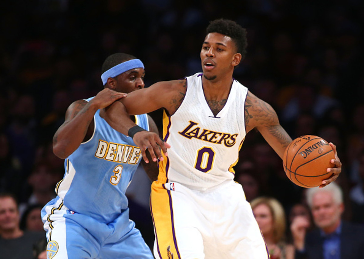 LOS ANGELES, CA - NOVEMBER 23:  Nick Young #0 of the Los Angeles Lakers gets his elbow up on Ty Lawson #3 of the Denver Nuggets in the first half during the NBA game at Staples Center on November 23, 2014 in Los Angeles, California. NOTE TO USER: User expressly acknowledges and agrees that, by downloading and or using this photograph, User is consenting to the terms and conditions of the Getty Images License Agreement.  (Photo by Victor Decolongon/Getty Images)