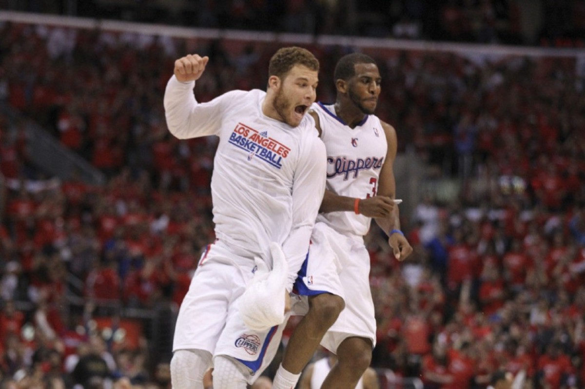 Los Angeles Clippers' Blake Griffin, left, and Chris Paul celebrate a basket during overtime in a NBA first-round playoff basketball game against the Memphis Grizzlies in Los Angeles, Monday, May 7, 2012. The Clippers won 101-97 in overtime.(AP Photo/Chris Carlson)