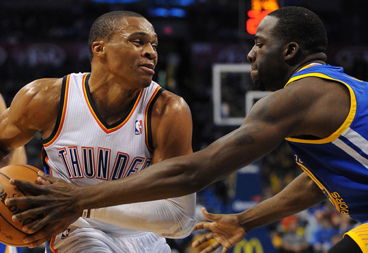 Nov 29, 2013; Oklahoma City, OK, USA;  Oklahoma City Thunder point guard Russell Westbrook (0) handles the ball against Golden State Warriors small forward Draymond Green (23) during the fourth quarter at Chesapeake Energy Arena. Mandatory Credit: Mark D. Smith-USA TODAY Sports