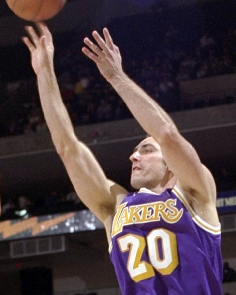 10 Dec 1997:  Guard Jon Barry of the Los Angeles Lakers shoots the ball during a game against the Golden State Warriors at the Oakland Coliseum in Oakland, California.  The Warriors won the game 93-92. Mandatory Credit: Todd Warshaw  /Allsport