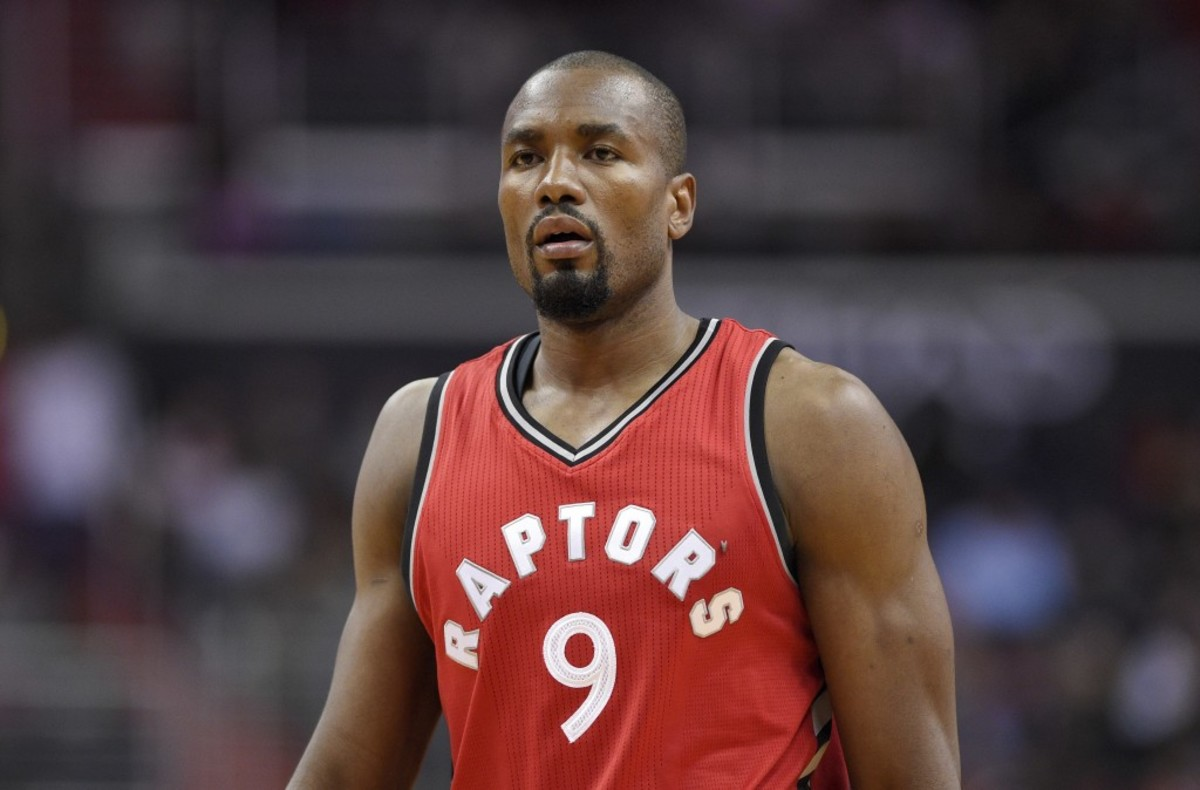 Toronto Raptors forward Serge Ibaka (9), of Congo, looks on during the first half of an NBA basketball game against the Washington Wizards, Friday, March 3, 2017, in Washington. (AP Photo/Nick Wass)