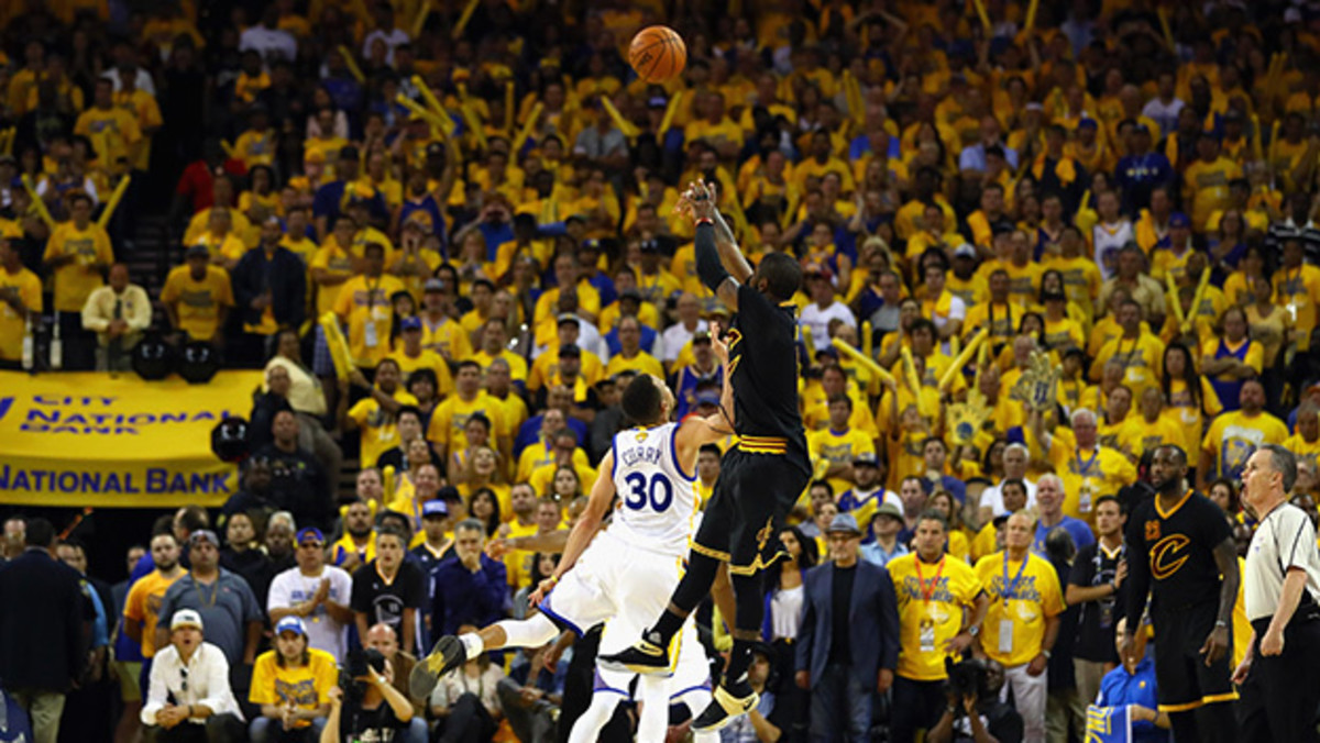 OAKLAND, CA - JUNE 19:  Kyrie Irving #2 of the Cleveland Cavaliers shoots a three-point basket late in the fourth quarter against Stephen Curry #30 of the Golden State Warriors in Game 7 of the 2016 NBA Finals at ORACLE Arena on June 19, 2016 in Oakland, California. NOTE TO USER: User expressly acknowledges and agrees that, by downloading and or using this photograph, User is consenting to the terms and conditions of the Getty Images License Agreement.  (Photo by Ezra Shaw/Getty Images)