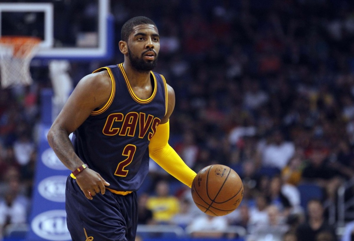 Mar 15, 2015; Orlando, FL, USA; Cleveland Cavaliers guard Kyrie Irving (2) drives to the basket against the Orlando Magic during the first quarter at Amway Center. Mandatory Credit: Kim Klement-USA TODAY Sports